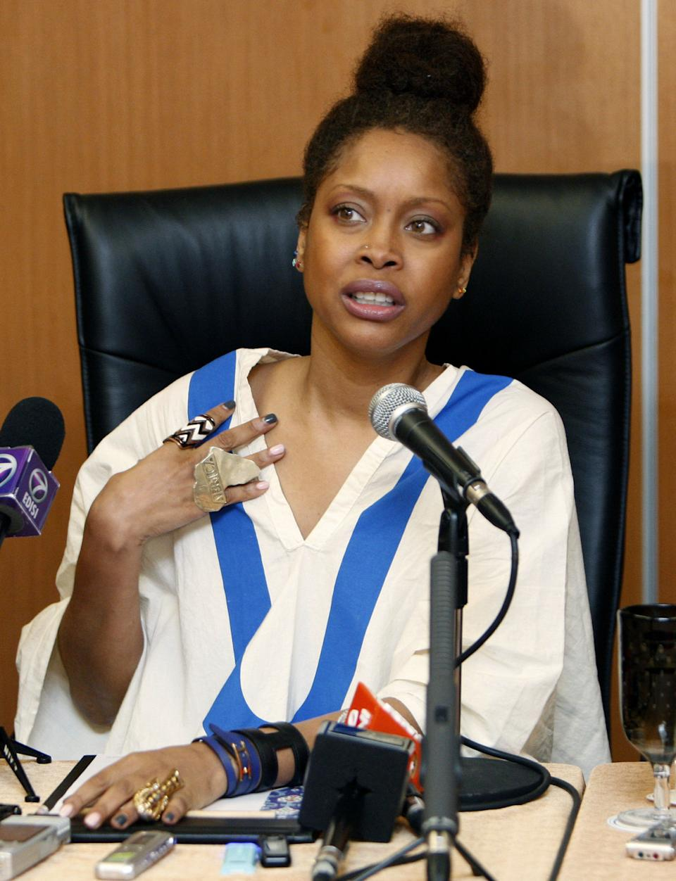 U.S. singer Erykah Badu speaks during a press conference in Kuala Lumpur, Malaysia, on Wednesday, Feb. 29, 2012. Muslim-majority Malaysia on Tuesday banned a planned concert by Badu after a photograph appeared showing the Grammy-winning singer with the Arabic word for Allah written on her body. (AP Photo/Lai Seng Sin)
