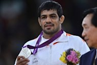 India's Sushil Kumar on the podium after winning his men's 66kg freestyle wrestling silver medal on August 12 at the London Olympics. Defeat by Tatsuhiro Yonemitsu of Japan saw Kumar, the 2010 world champion, add Olympic silver to the bronze he won in Beijing four years ago