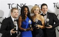 James Corden, Audra McDonald, Nina Arianda, and Steve Kazee pose backstage with their awards during the American Theatre Wing's 66th annual Tony Awards in New York