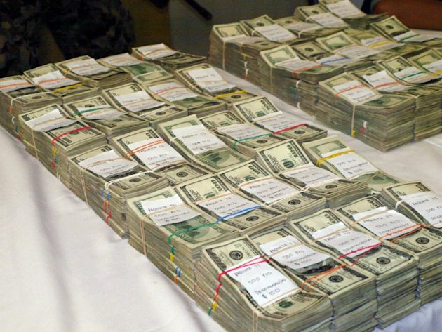 This undated photo, provided by U.S. Immigrations and Customs Enforcement (ICE), shows bulk cash seized during a combined ICE and Homeland Security Investigation (HSI) operation. Immigration agents report a rising number of cash seizures and arrests in the past half-dozen years as criminals, sidestepping scrutiny from banks over electronic transfers, resort to using cash to conceal proceeds from drug trafficking as they move the money south to crime rings in Mexico and elsewhere.