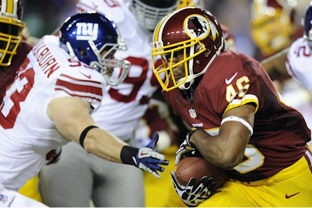 Washington Redskins running back Alfred Morris (46) carries the ball past New York Giants middle linebacker Chase Blackburn (93) during the first half of an NFL football game in Landover, Md., Monday,