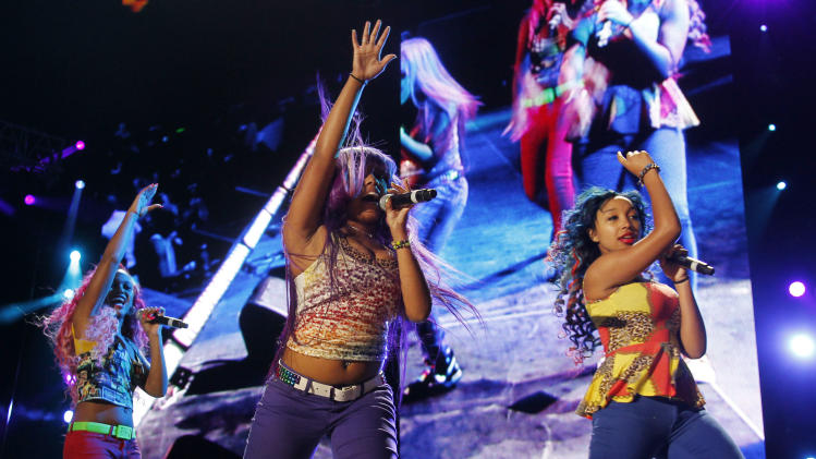 The OMG Girls perform at the Essence Music Festival in New Orleans, Thursday, July 5, 2012. This is the first day of the four day music festival. (Photo by Bill Haber/Invision/AP)