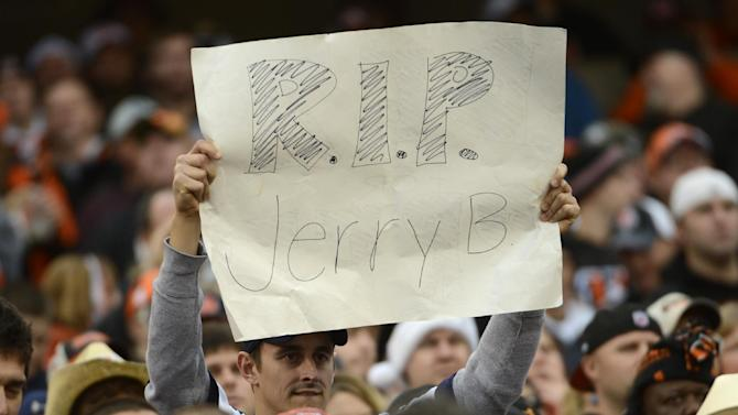 A fan holds a sign for Dallas Cowboys player Jerry Brown who was killed in an automobile accident during an NFL football game against the Cincinnati Bengals, Sunday, Dec. 9, 2012, in Cincinnati. (AP Photo/Michael Keating)