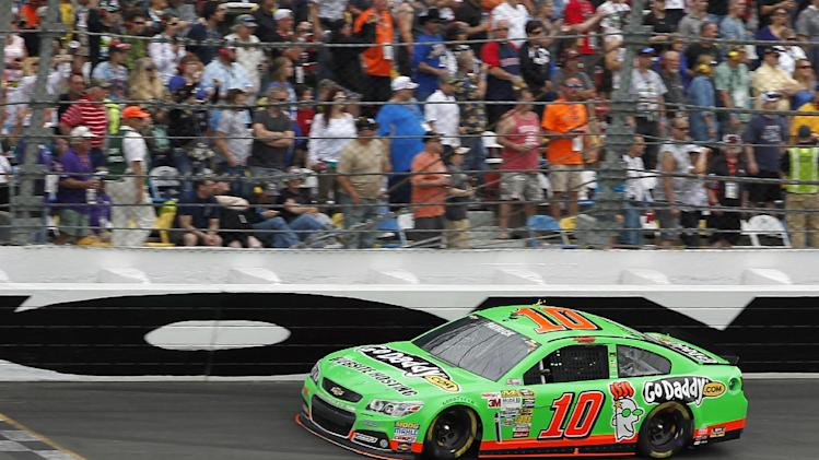 Danica Patrick competes during NASCAR Daytona 500 Sprint Cup Series auto race at Daytona International Speedway, Sunday, Feb. 24, 2013, in Daytona Beach, Fla. (AP Photo/Terry Renna)