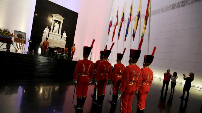 Members of Venezuela's honour guard stand during a change of guards at Simon Bolivar's mausoleum in Caracas
