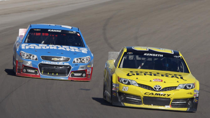 Matt Kenseth (20) leads Kasey Kahne (5) during the final laps of a NASCAR Sprint Cup Series auto race on Sunday, March 10, 2013, in Las Vegas. Kenseth won the race. (AP Photo/Isaac Brekken)