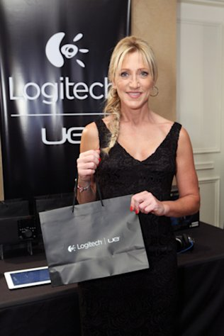 Edie Falco grabs some swag at the 10th Annual HBO Luxury Lounge in honor of the 2012 Emmy Awards.