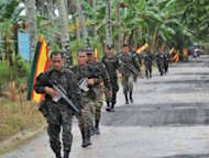 "Moro Islamic Liberation Front (MILF) rebels on patrol on the southern Philippine island of Mindanao in 2011. The Philippines said it has brokered a ""significant"" agreement with the Muslim rebels on how to end a decades-long insurgency, but warned that major issues still needed to be resolved"