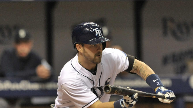 Tampa Bay Rays' Nick Franklin squares to bunt during a baseball game against the Seattle Mariners Tuesday, May 26, 2015, in St. Petersburg, Fla. (AP Photo/Steve Nesius)
