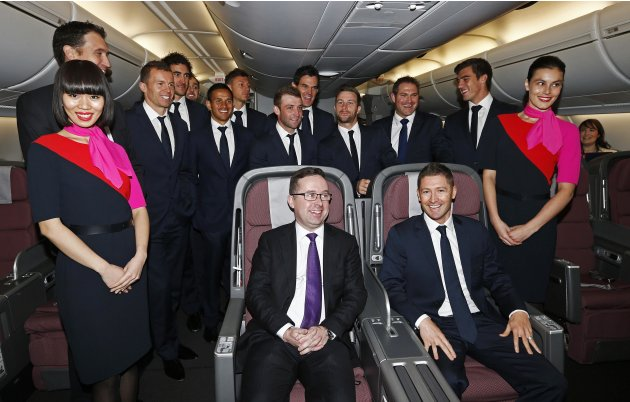 Australia cricket captain Clarke and Qantas CEO Joyce pose for pictures onboard a Qantas A380 aircraft in Sydney