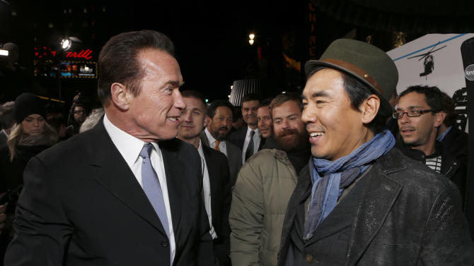 "Arnold Schwarzenegger and Director Jee-woon Kim attend the LA premiere of ""The Last Stand"" at Grauman's Chinese Theatre on Monday, Jan. 14, 2013, in Los Angeles. (Photo by Todd Williamson/Invision/AP)"
