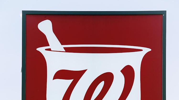 This Friday, June 21, 2013 photo shows a sign in front of the Walgreens in Wexford, Pa. Walgreen Co. reports quarterly financial results, Tuesday, June 25, 2013. (AP Photo/Keith Srakocic)