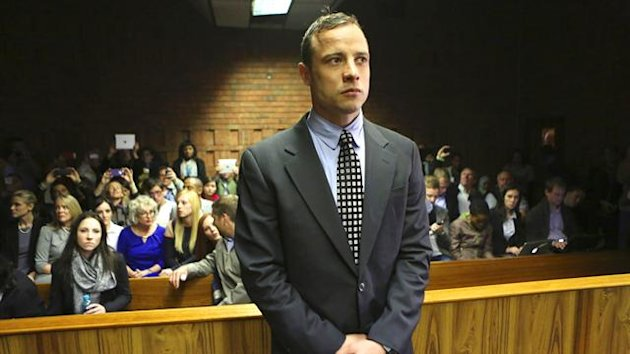 Oscar Pistorius enters the dock at Pretoria Magistrates court June 4, 2013. (Reuters)