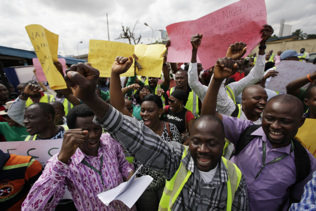 "Former Air Nigeria staff protest after they were fired in Lagos, Nigeria, Friday, Sept. 7, 2012. More than 60 workers from Air Nigeria protested Friday at Lagos' Murtala Muhammed International Airport's domestic terminal, demanding four-months-worth of unpaid salaries from the company. The airline's owner, business tycoon Jimoh Ibrahim, fired nearly all of the company's 800 employees for ""disloyalty"" earlier this month. (AP Photo/Sunday Alamba)"