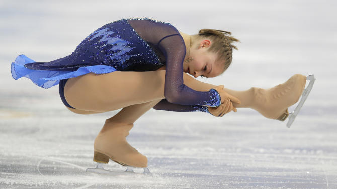 Yulia Lipnitskaya of Russia competes in the women's team short program figure skating competition at the Iceberg Skating Palace during the 2014 Winter Olympics, Saturday, Feb. 8, 2014, in Sochi, Russia. (AP Photo/Vadim Ghirda)