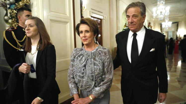 U.S. House Minority Leader Pelosi and her husband arrive for a reception for the Kennedy Center Honors recipients at the White House in Washington