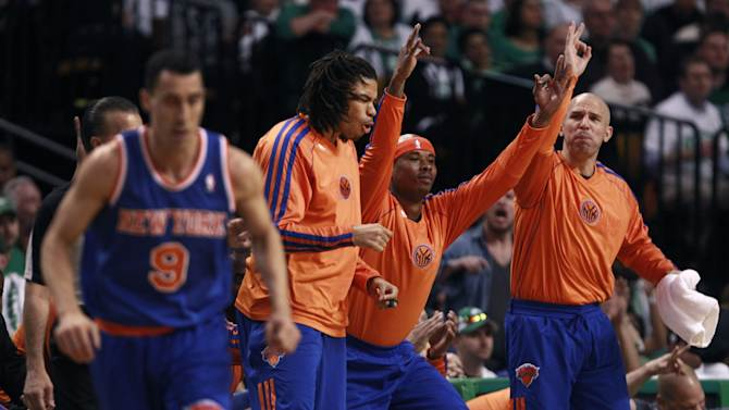 New York Knicks guard Jason Kidd, right, celebrates a three-point basket by teammate Pablo Prigioni during the first quarter against the Boston Celtics in Game 6 of their first-round NBA basketball playoff series in Boston, Friday, May 3, 2013.  From left to right, are: Prigioni (9), Chris Copeland, Quentin Richardson and Kidd. (AP Photo/Charles Krupa)