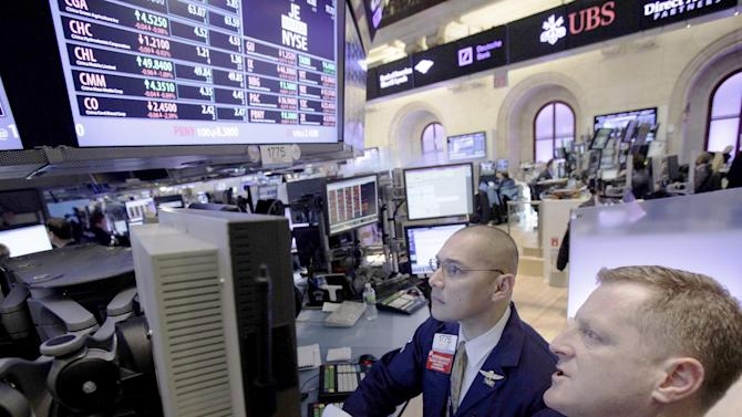 In this Jan. 30, 2012 photo, specialists Mark Otto, left, and Christopher Malloy work on the floor of the New York Stock Exchange. Markets clawed back lost ground Tuesday, Jan. 31, 2012, on hopes that Greece is heading toward a conclusion of debt-reduction talks with private creditors and that it may secure its second bailout package this week. (AP Photo/Richard Drew)