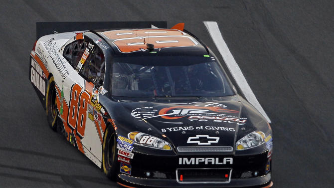 Dale Earnhardt Jr. (88) drives down the front stretch during the NASCAR Sprint Cup Series Sprint Showdown auto race in Concord, N.C., Saturday, May 19, 2012. Earnhardt won the Showdown to advance to the All-Star race. (AP Photo/Gerry Broome)