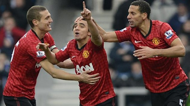 Manchester United's Rafael da Silva (L) celebrates scoring with Rio Ferdinand (R) and Nemnja Vidic (Reuters)