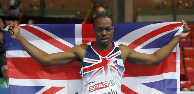 Dasaolu of Britain celebrates winning second place in the 60m Men Final at the European Athletics Indoor Championships in Gothenburg