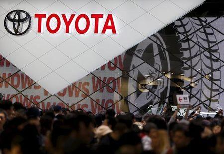 Visitors crowd Toyota Motor Corp's booth at the 44th Tokyo Motor Show in Tokyo, Japan