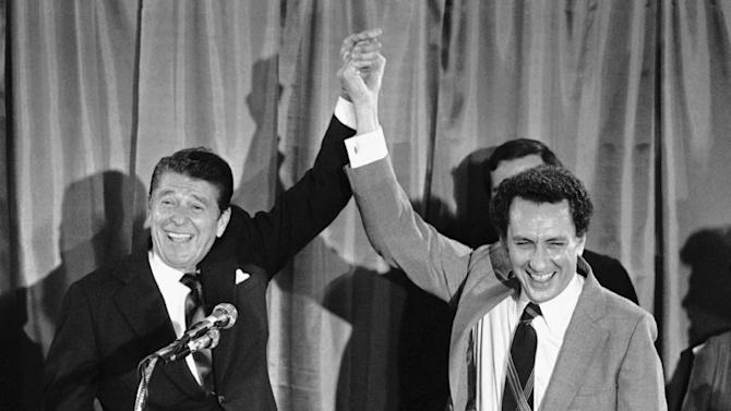 FILE - In an Aug.19, 1980 file photo, Republican presidential candidate Ronald Reagan holds up  U.S. Senate candidate Arlen Specter's hand at fund-raising party for Specter in Philadelphia. Former U.S. Sen. Arlen Specter, longtime Senate moderate and architect of one-bullet theory in JFK death, died Sunday, Oct. 14, 2012.  He was 82. (AP Photo/Walter Zeboski, File)