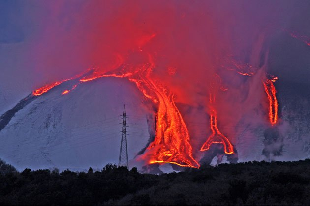 Red hot lava flows down Italian …