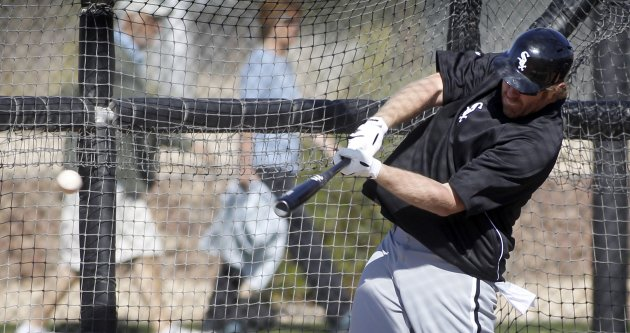 Chicago White Sox's Adam Dunn takes batting practice during MLB Cactus League spring training workouts at the team's facility in Glendale