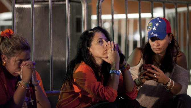 Supporters of opposition presidential candidate Henrique Capriles wait for results at the campaign headquarters in Caracas, Venezuela, Sunday, Oct. 7, 2012. Venezuela's electoral council says President Hugo Chavez has won re-election, defeating challenger Capriles. (AP Photo/Ariana Cubillos)