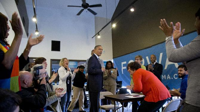President Barack Obama is applauded as he visits with volunteers at a campaign office the morning of the 2012 election, Tuesday, Nov. 6, 2012, in Chicago. (AP Photo/Carolyn Kaster)