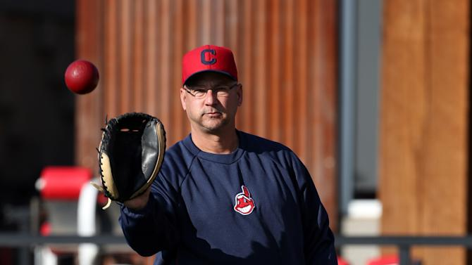 Cleveland Indians manager Terry Francona catches a ball during spring training baseball in Goodyear, Ariz., Tuesday, Feb. 12, 2013.  (AP Photo/Paul Sancya)
