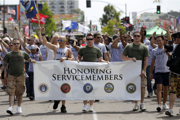 FILE - This July 16, 2011 file photo shows members of the military marching in the Gay Pride Parade in San Diego. The Defense Department on Thursday, July 19, 2012 announced it is allowing service mem