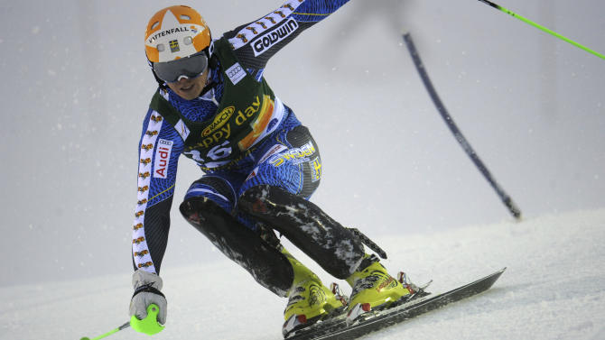 Sweden's Jens Byggmark slaloms past a pole on his way to clock the third fastest time during the first run of an alpine ski, men's World Cup slalom, in Levi, Finland, Sunday, Nov. 11 , 2012. (AP Photo/Giovanni Auletta)