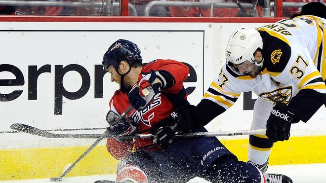 Dennis Wideman #6 Of The Washington Capitals And Patrice Bergeron #37 Of The Boston Bruins Battle For The Puck In Getty Images