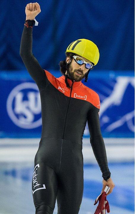 Charles Hamelin of Canada celebrates after he won the bronze medal in men's 1500m at the  Short Track Speed Skating World Championships in Debrecen, Hungary, Friday, March 8, 2013. (AP Photo/MTI, Tibo