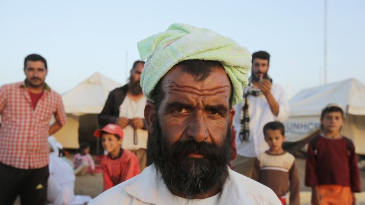 A man from minority Yazidi sect, who fled violence in Iraqi town of Sinjar, looks on in Bajed Kadal refugee camp, southwest of Dohuk province
