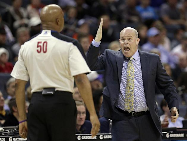 Charlotte Bobcats head coach Steve Clifford, right, argues a call with referee Olandis Poole, left, during the first half of an NBA basketball game against the Milwaukee Bucks, Monday, Dec. 23, 2013,