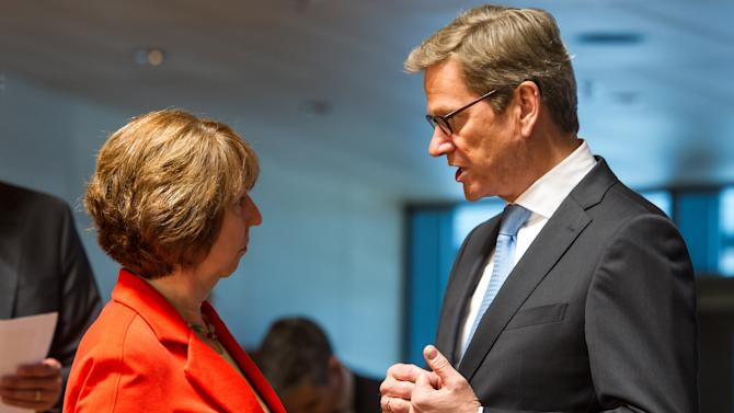 European foreign policy chief Catherine Ashton, left, talks with German Foreign Minister Guido Westerwelle during a European foreign ministers meeting in Luxembourg, Monday, June 24, 2013. (AP Photo/Geert Vanden Wijngaert)