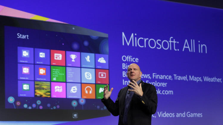 FILE - Microsoft CEO Steve Ballmer gives his presentation at the launch of Microsoft Windows 8, in New York,  in this Oct. 25, 2012 file photo. Microsoft is retooling the latest version of its Windows operating system to address complaints and confusion that have been blamed for deepening a slump in personal computer sales. The tune up announced Tuesday May 7, 2013 won't be released to consumers and businesses until later this year.   (AP Photo/Richard Drew, File)