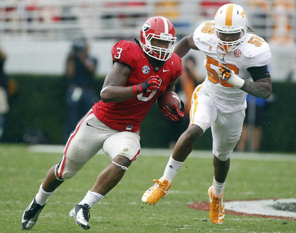 Georgia running back Todd Gurley (3) runs for a touchdown as Tennessee linebacker Curt Maggitt (56) gives chase during the first half of an NCAA college football game in Athens, Ga., on Saturday, Sept. 29, 2012. (AP Photo/John Bazemore)