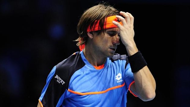 David Ferrer reacts after a point against Serbia's Janko Tipsarevic at the ATP World Tour Finals in London (AFP)