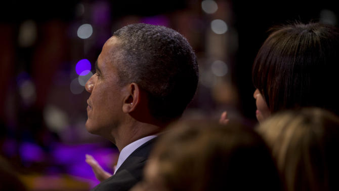President Barack Obama and first lady Michelle Obama watch as singer-songwriter Carole King performs after being presented the Library of Congress Gershwin Prize for Popular Song during an East Room concert honoring King Wednesday, May 22, 2013, at the White House in Washington. (AP Photo/Jacquelyn Martin)