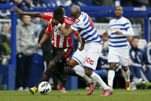 Queens Park Rangers' Mbia challenges Sunderland's N'Diaye during their English Premier League soccer match in London