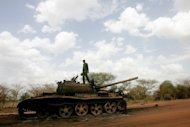 A soldier is seen atop a destroyed tank for the Sudanese Peoples Liberation Army of South Sudan in the oil region of Heglig on April 23. Sudan, which has rejected a return to the negotiating table, accused South Sudan of undermining its stability by backing rebels inside its territory despite international appeals for it to stop
