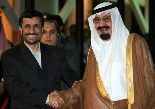 Saudi King Abdullah bin Abdul Aziz al-Saud (right) greets Iranian President Mahmoud Ahmadinejad during a 2007 visit to Riyadh. Ahmadinejad is to attend an extraordinary summit of Muslim leaders in the holy city of Mecca next week at the invitation of the Saudi king, an aide said on Monday