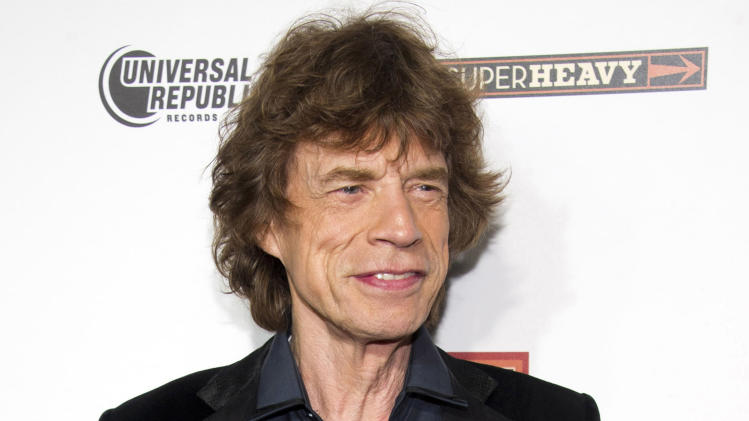 """FILE - In this Sept. 21, 2011 file photo, SuperHeavy member Mick Jagger attends the release party for the band's new CD, """"SuperHeavy"""", in New York. Jagger will host the """"Saturday Night Live"""" finale on May 19. (AP Photo/Charles Sykes, file)"""