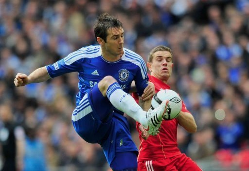 Chelsea midfielder Frank Lampard (left) vies with Liverpool's Jordan Henderson during the FA Cup final at Wembley