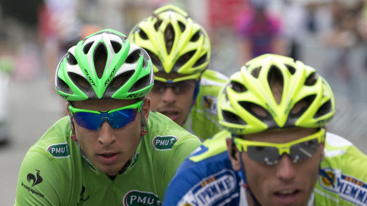 Peter Sagan of Slovakia, wearing the best sprinter's green jersey, left, rides with two teammates to the finish line after crashing in the last kilometers of the fifth stage of the Tour de France cycling race over 196.5 kilometers (122 miles) with start in Rouen and finish in Saint-Quentin, France, Thursday July 5, 2012. (AP Photo/Joel Saget, Pool)
