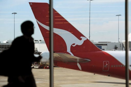 <p>A Qantas plane sits on the tarmac at Sydney International Airport. The struggling Australian carrier on Thursday announced a major global alliance with Emirates that will involve moving its hub for European flights to Dubai from Singapore.</p>